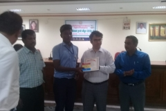 R. RENNIE ANDERSON- Std XII  Receiving Third Prize from Kanyakymari District Collector  classes for XI-XII (Group) Category in the World Small Savings Day Dance Competition conducted for Kanyakumari Dist